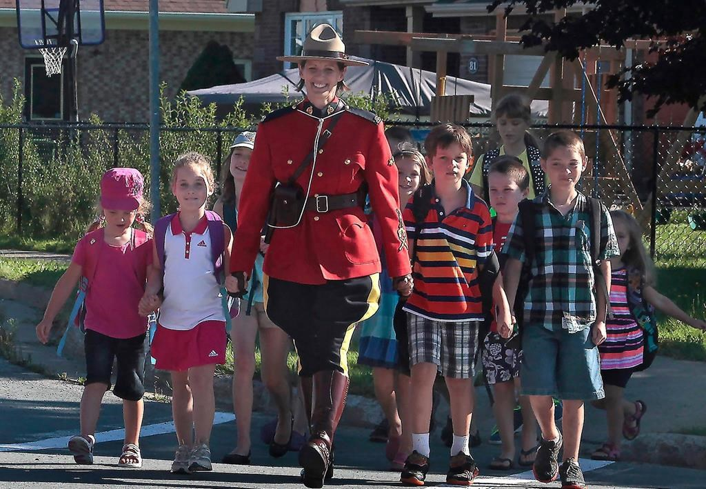 RCMP Const. Heidi Stevenson is shown with children in an undated hadout photo.