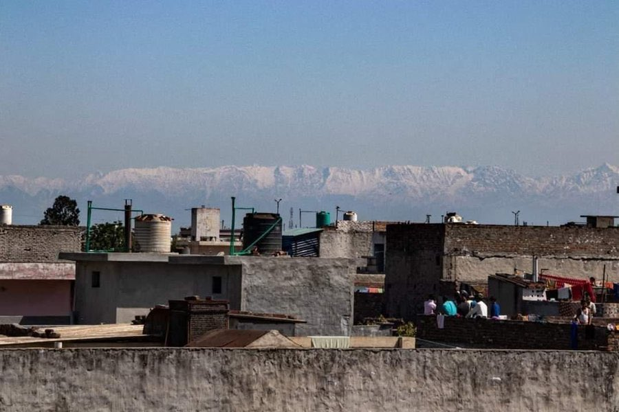 The Himalayas are shown in the distance from Jalandhar in the Indian state of Punjab on April 3, 2020.
