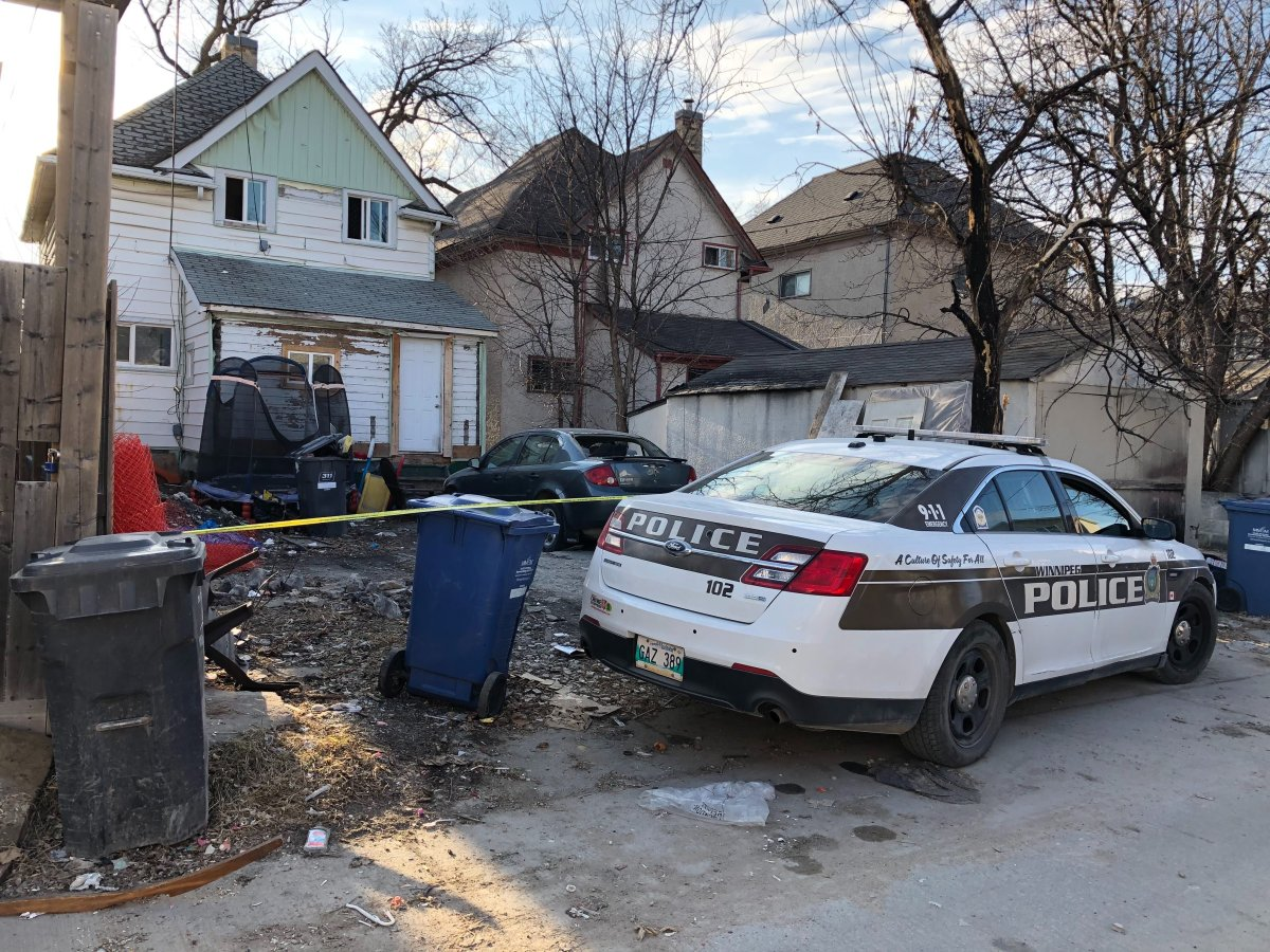 Police tape surrounds a Victor Street home where Noah Soloman Nigussie. 23, was shot and killed in April. Police now say an arrest has been made in the case.