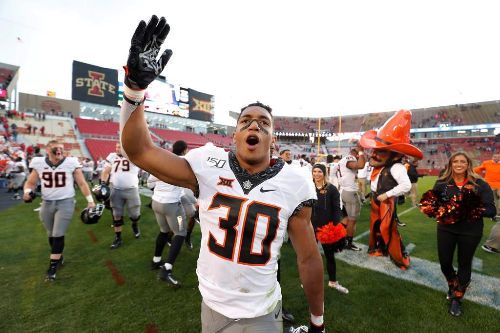 Oklahoma State running back Chuba Hubbard blows a kiss to Oklahoma State fans after their 34-27 win over Iowa State in an NCAA college football game in Ames, Iowa, on Oct. 26, 2019. Canadian Chuba Hubbard will have a tough act to follow this season. His own. The 20-year-old native of Sherwood Park, Alta., was the NCAA rushing leader last season, running for 1,936 yards and 21 TDs. That left the Oklahoma State star eighth in voting for the Heisman Trophy, presented annually to American college football's top player. THE CANADIAN PRESS/AP - Matthew Putney.