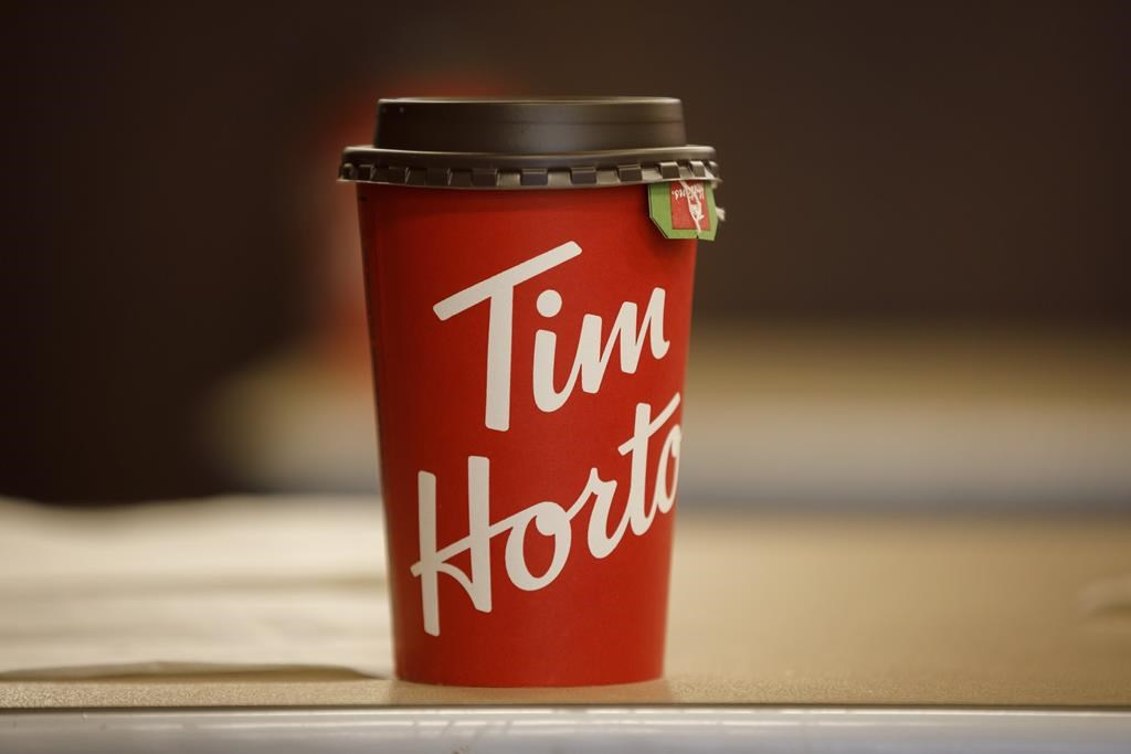 A Tim Hortons cup is seen inside a Tim Hortons restaurant in Toronto on March 6, 2020.