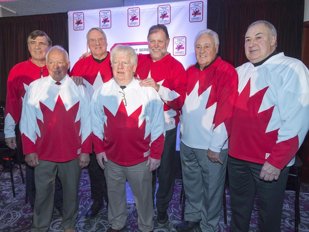 Team Canada 1972 players Serge Savard, left, Yvan Cournoyer, Ken Dryden, Pat Stapleton, Peter Mahovolich, Phil Esposito and Guy Lapointe, right, pose for photos at a news conference, in Montreal on Tuesday, Feb. 9, 2016. Pat Stapleton, a longtime NHL defenceman who famously kept an air of mystery over whether he had possession the puck from the goal that won the 1972 Summit Series, has died. He was 79. THE CANADIAN PRESS/Ryan Remiorz.