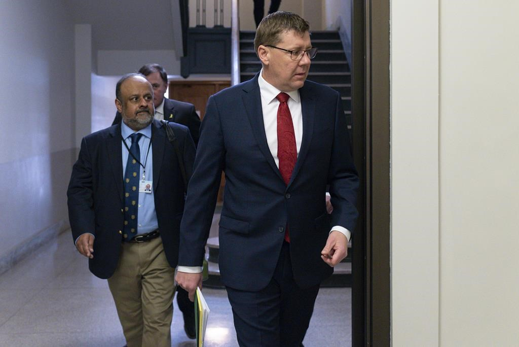 Saskatchewan Premier Scott Moe and Saqib Shahab, chief medical health officer, arrive to a COVID-19 news update at the legislative building in Regina on Wednesday March 18, 2020.