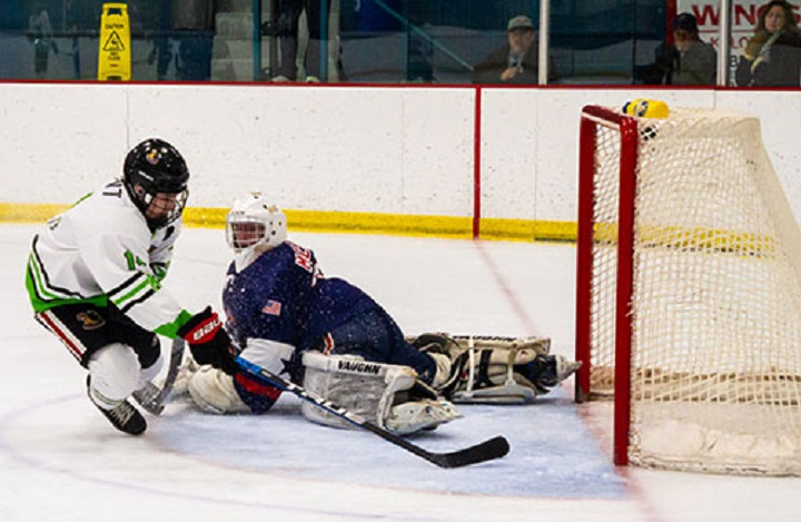 Kayson Gallant scores a goal against the Spokane Braves, the lone KIJHL organization south of the border.