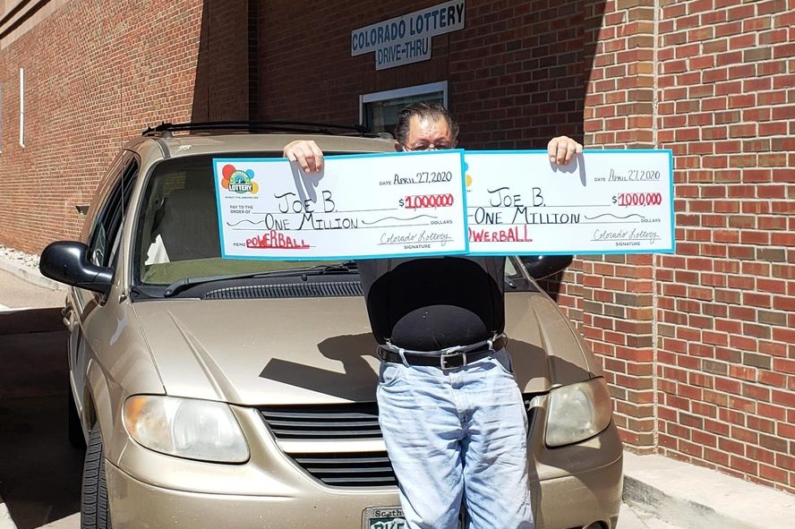 'Joe B.' of Pueblo, Colo., shows off his two million-dollar prizes outside the Colorado Lottery office on Apr. 27, 2020.