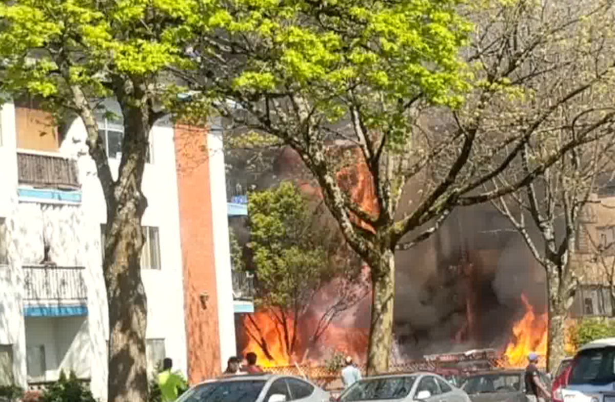 Flames shoot out of a Vancouver apartment building on April 18, 2020.