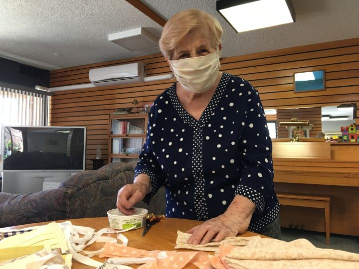 Maria Gal with some of the more than 400 protective masks she's sewn during the COVID-19 pandemic.