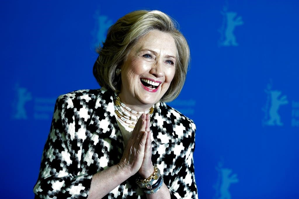 In this Feb. 2020 photo, Former US Secretary of State, Hillary Clinton, poses for the photographers during a photo-call for the film 'Hillary' ' during the 70th International Film Festival Berlin, Berlinale in Berlin, Germany.