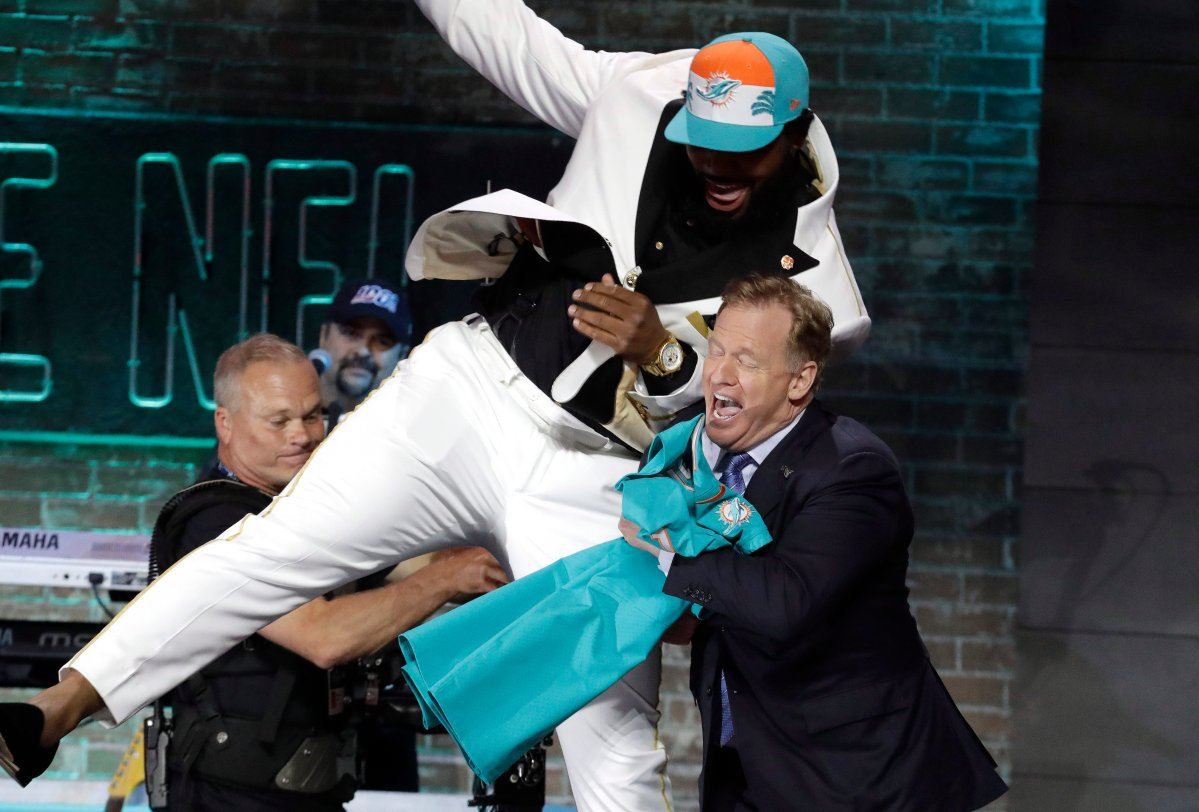 Clemson defensive tackle Christian Wilkins jumps into NFL commissioner Roger Goodell's arms after the Miami Dolphins selected Wilkins in the first round at the 2019 NFL football draft in Nashville, Tenn.