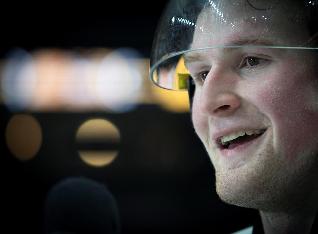 In this Jan. 16, 2020, file photo, Team White left winger Alexis Lafreniere smiles following hockey's CHL Top Prospects Game in Hamilton, Ontario.