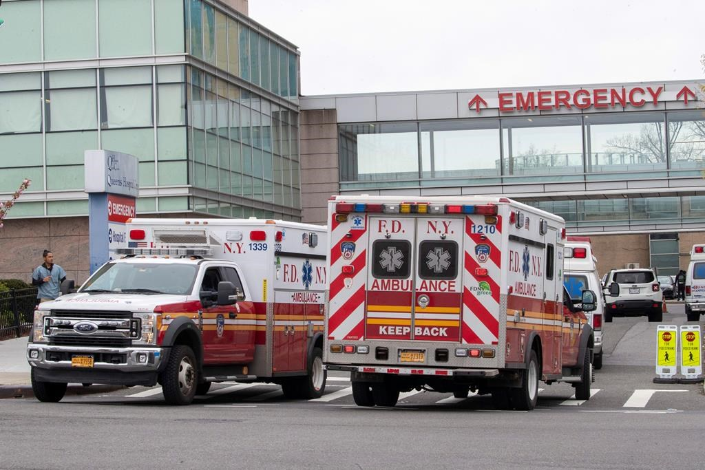 FILE: FDNY ambulances are seen entering and leaving the emergency room at Queens Hospital Center, Monday, April 20, 2020, in the Jamaica neighborhood of the Queens borough of New York.