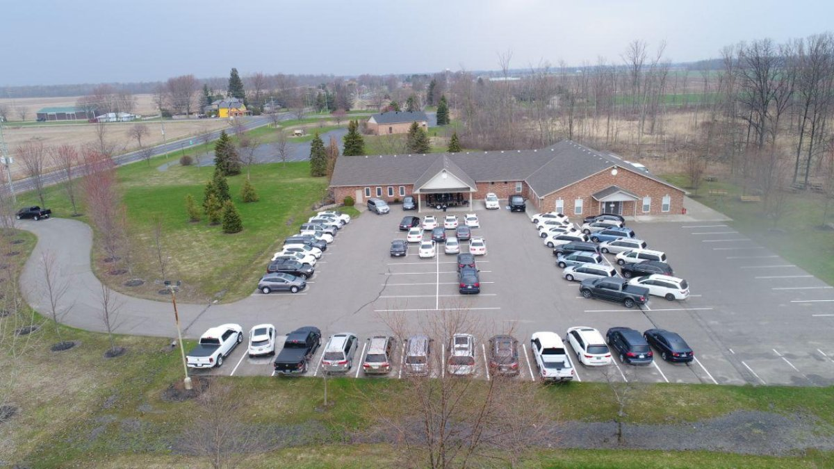 An aerial image captures a full parking lot at the Church of God in Aylmer Ont. as drive-in church service takes place Sunday morning.