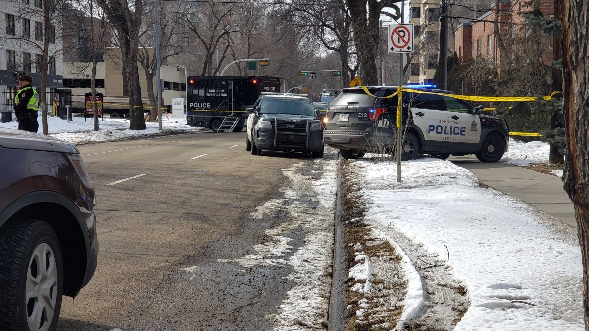 """An Edmonton police vehicle """"briefly"""" connected with a suspect during an arrest at 100 Avenue and 110 Street on Saturday afternoon."""
