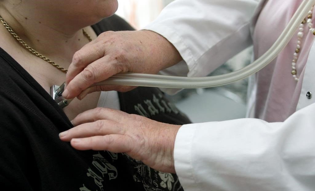 A doctor examines a patient with a stethoscope in her doctor's office in Stuttgart, Germany, Monday, April 28, 2008.