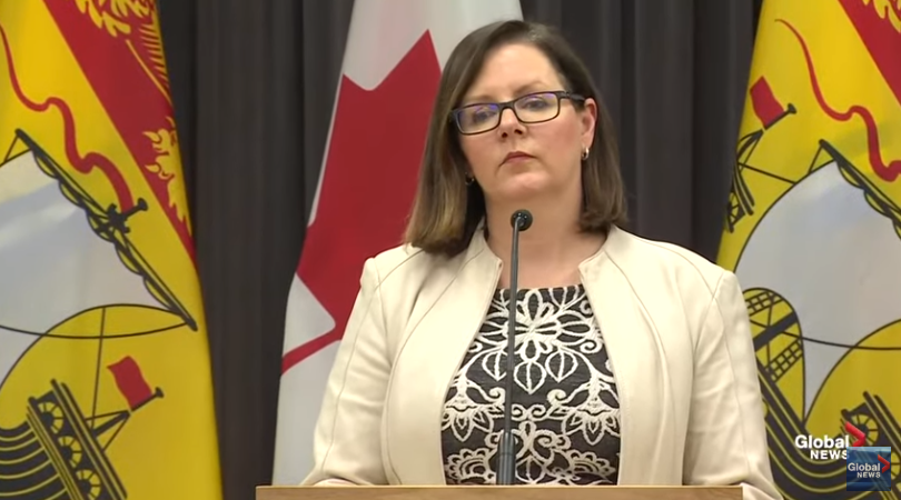 Dr. Jennifer Russell speaks at a press briefing.