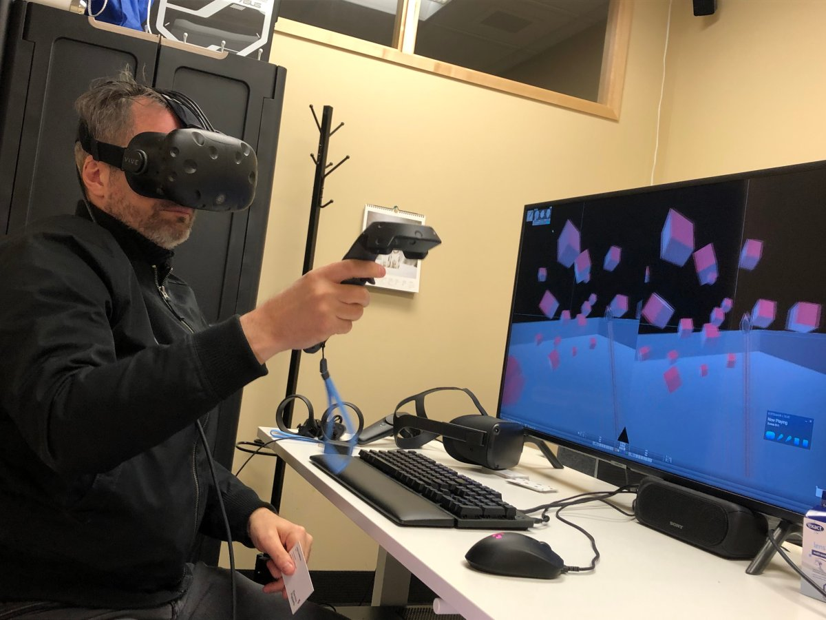 Ryan Cameron, CEO and founder of Electric Puppets, demonstrates his virtual reality software at the office in Halifax on April 7, 2020.