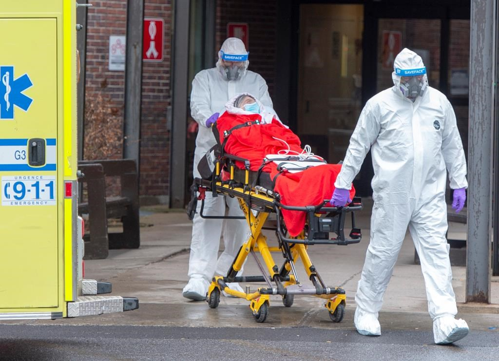 A resident is transported from the CHSLD Lasalle seniors residence Tuesday April 21, 2020 in Montreal.