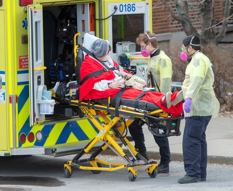 Paramedics transfer a patient to the emergency unit at Verdun Hospital, Tuesday, April 14, 2020 in Montreal.