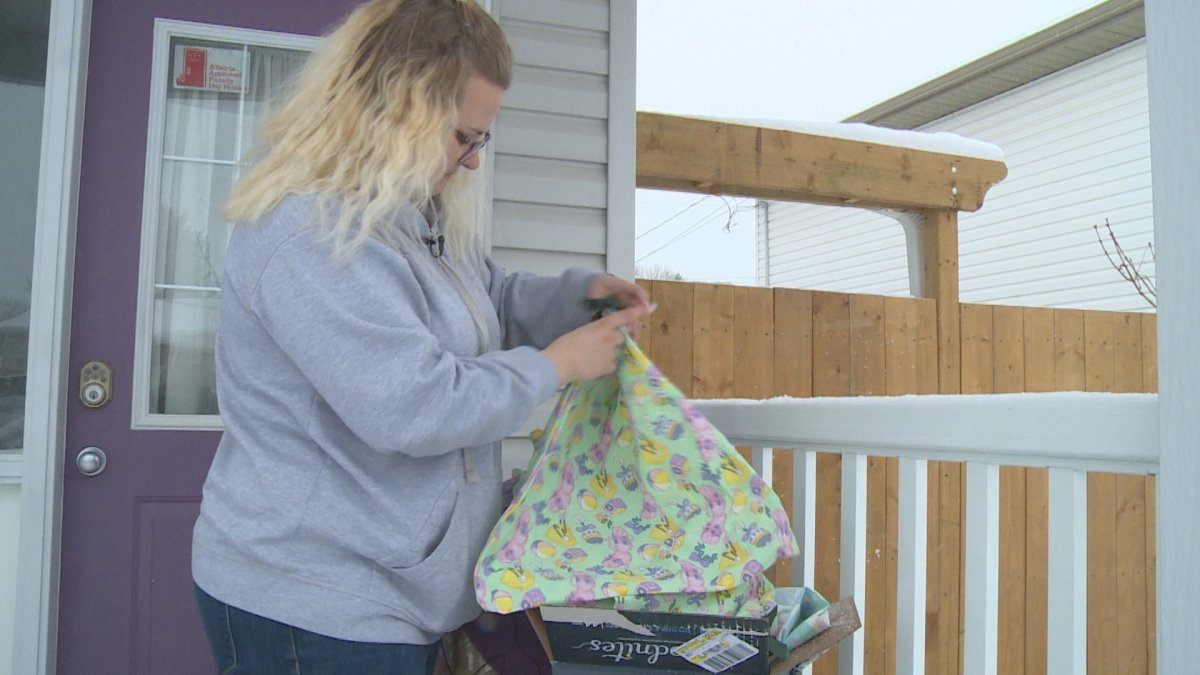 Cora Walkey shows off the reusable bags Stitch It Forward is donating to health-care workers in and around Lethbridge.