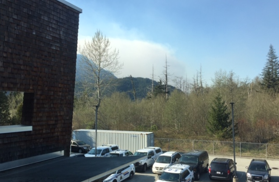 Smoke can be seen from the wildfire north of Squamish. Police say the wildfire was sparked when a slash burn got out of control.