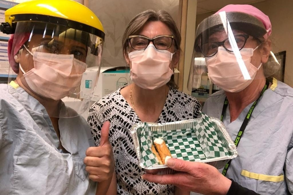 Health-care workers at Hamilton's Urgent Care Centre pose with (the remainder of) a donation of cannoli from a local food truck.