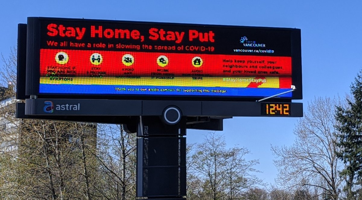 An illuminated sign in Vancouver asks residents to stay home during the COVID-19 pandemic.