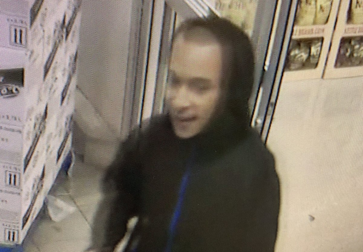 Guelph police released a photo of a man after a grocery store clerk was spat on.