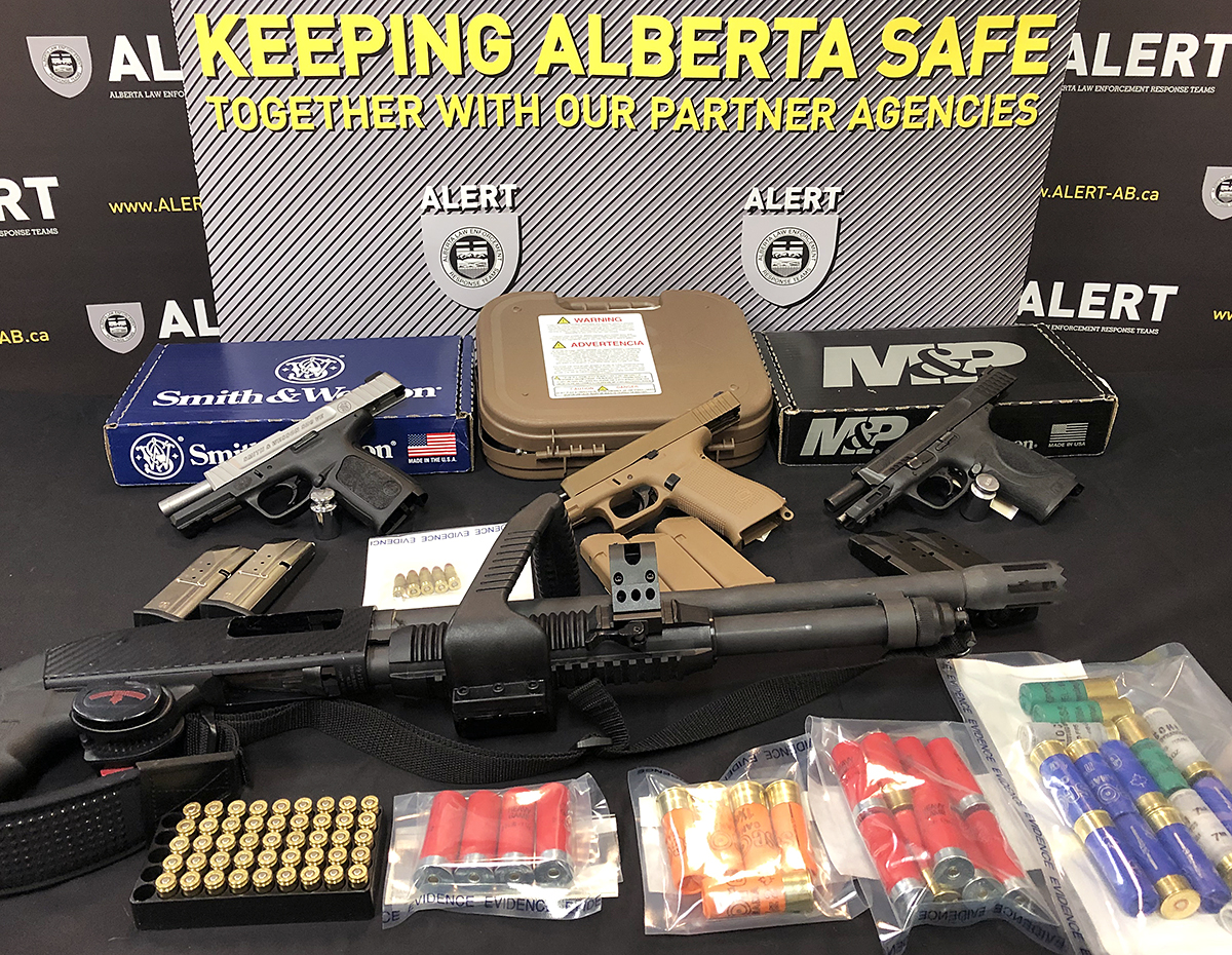 Grande Prairie man facing 31 charges after restricted handguns allegedly sold to criminals - image