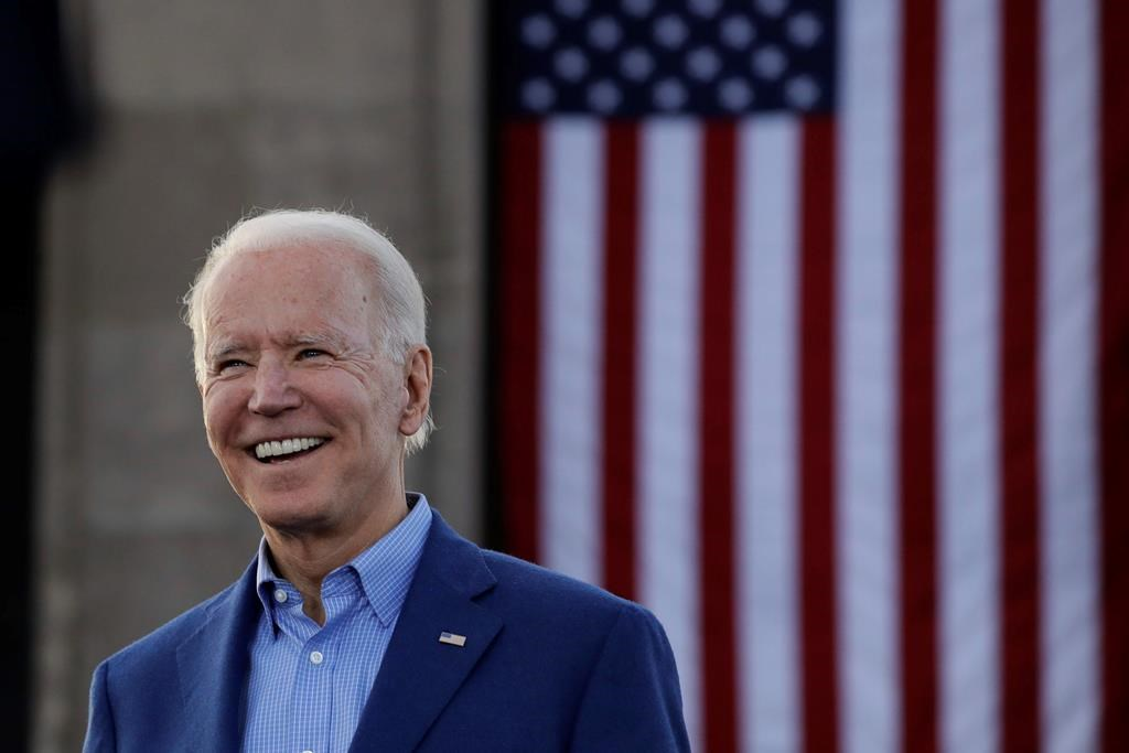 In this March 7, 2020, file photo Democratic presidential candidate former Vice President Joe Biden acknowledges the crowd during a campaign rally in Kansas City, Mo. Biden's campaign says the former vice-president will rip up President Donald Trump's approvals for the Keystone XL pipeline if he takes over the White House next year. THE CANADIAN-AP Photo/Charlie Riedel, File.