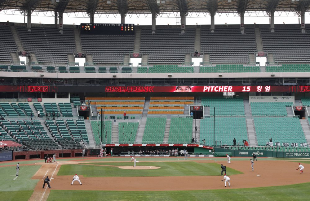 Stadium seats are empty as a part of precaution against the new coronavirus during a baseball game between Hanwha Eagles and SK Wyverns in Incheon, South Korea, Tuesday, May 5, 2020. With umpires fitted with masks and cheerleaders dancing beneath vast rows of empty seats, a new baseball season got underway in South Korea following a weeks-long delay because of the coronavirus pandemic.