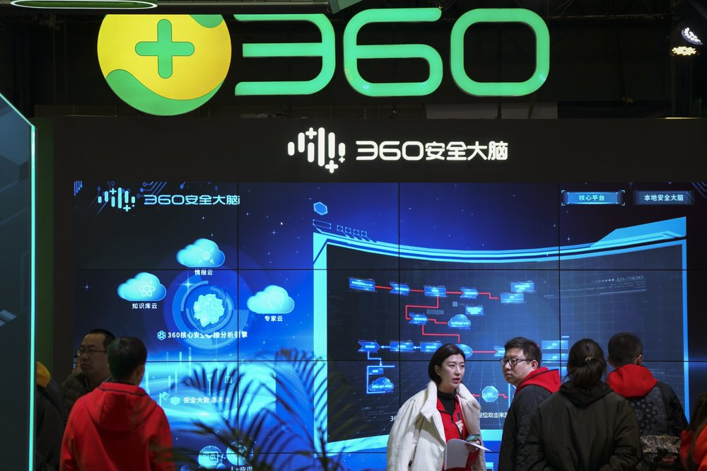 """In this photo released by Xinhua News Agency, visitors tour the Chinese internet security firm Qihoo 360 showcasing it 5G digital security and protection system at the World 5G Convention in Beijing on Nov. 21, 2019. One of China's biggest tech companies has criticized the Trump administration for """"politicizing business"""" after it slapped export sanctions on 33 more Chinese enterprises and government entities."""