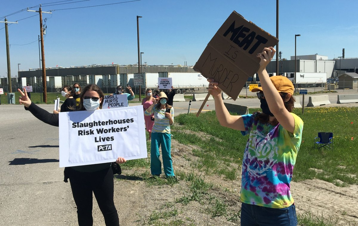 People protest conditions at the Cargill meat-packing plant in High River, Alta., on Saturday, May 30, 2020.