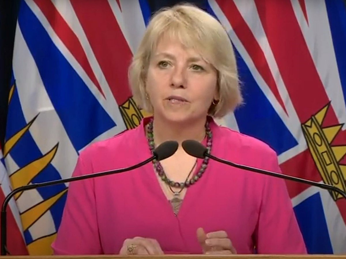 Provincial health officer Dr. Bonnie Henry looks on while answering a question during her daily announcement of coronavirus statistics in B.C., on Saturday, May 23, 2020.