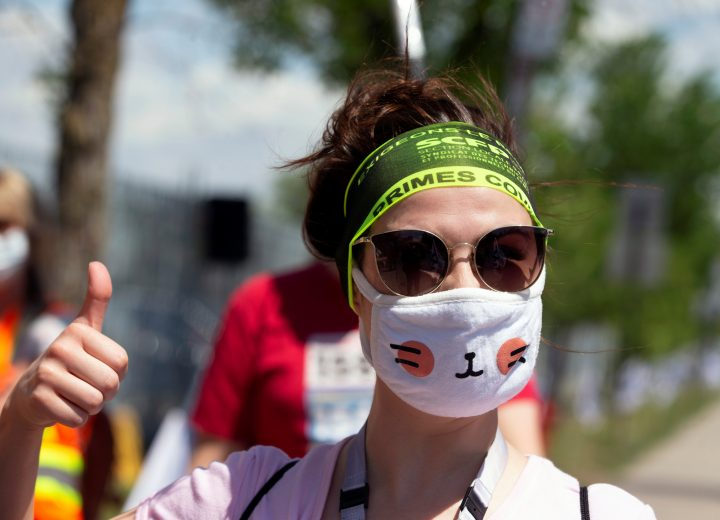 A woman wearing a face mask gives a thumbs-up as healthcare workers, professionals and unions demanding safer working conditions and time off amid the coronavirus disease (COVID-19) outbreak protest in front of Santa Cabrini Hospital in Montreal, Quebec, Canada May 29, 2020.