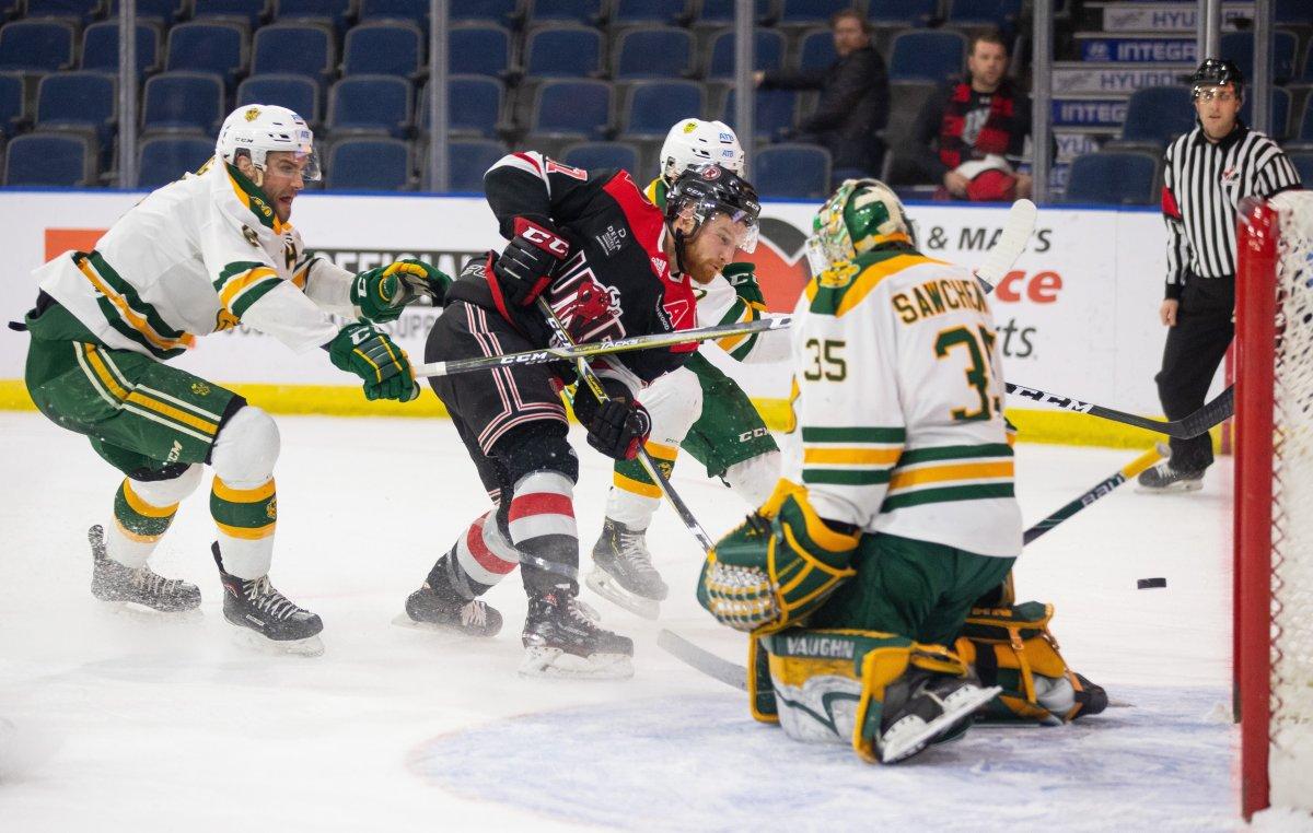 UNB Reds' Christopher Clapperton gets stopped by University of Alberta Golden Bears goaltender Zach Sawchenko during the U Sports Men's Hockey final, in Lethbridge, Alta., Sunday, March 17, 2019.