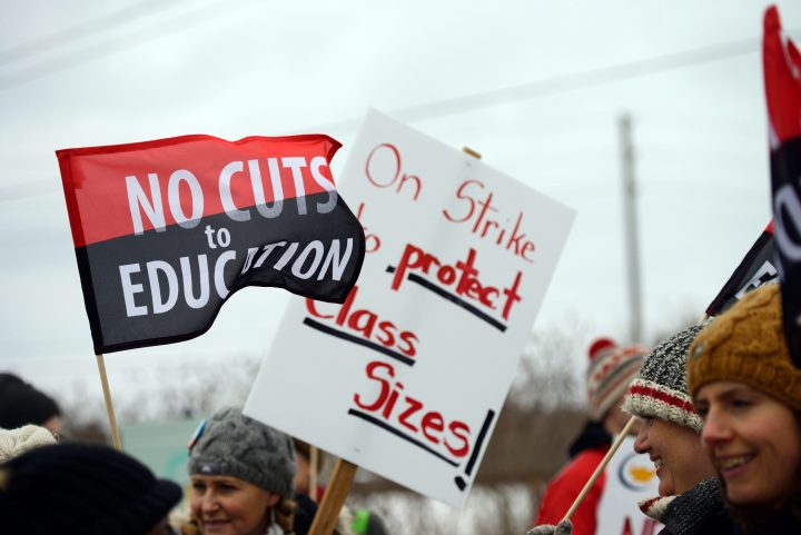 Teachers are shown on the picket line in front of a high school in Guelph, Ont., December 4, 2019.