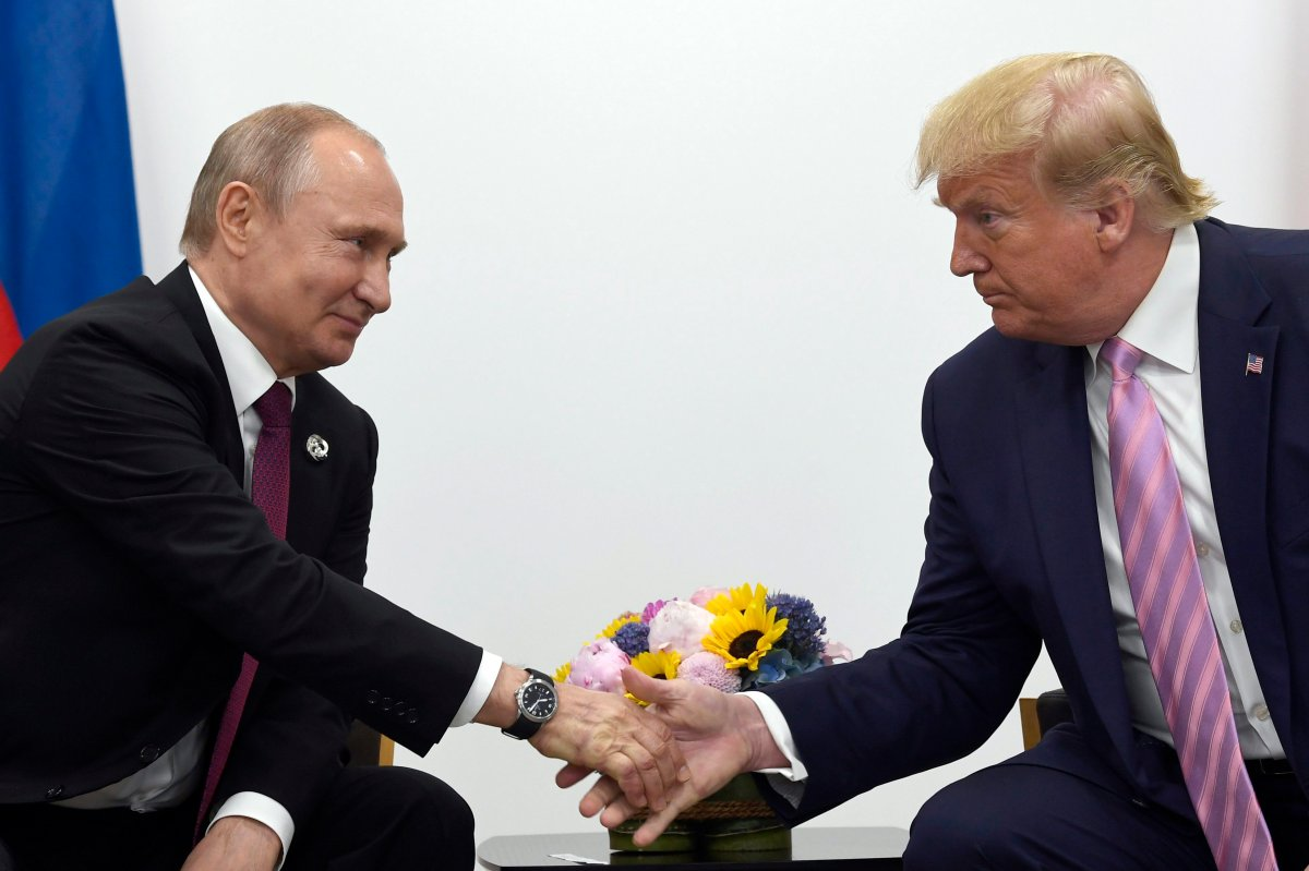 In this June 28, 2019, file photo, President Donald Trump, right, shakes hands with Russian President Vladimir Putin, left, during a bilateral meeting on the sidelines of the G-20 summit in Osaka, Japan.