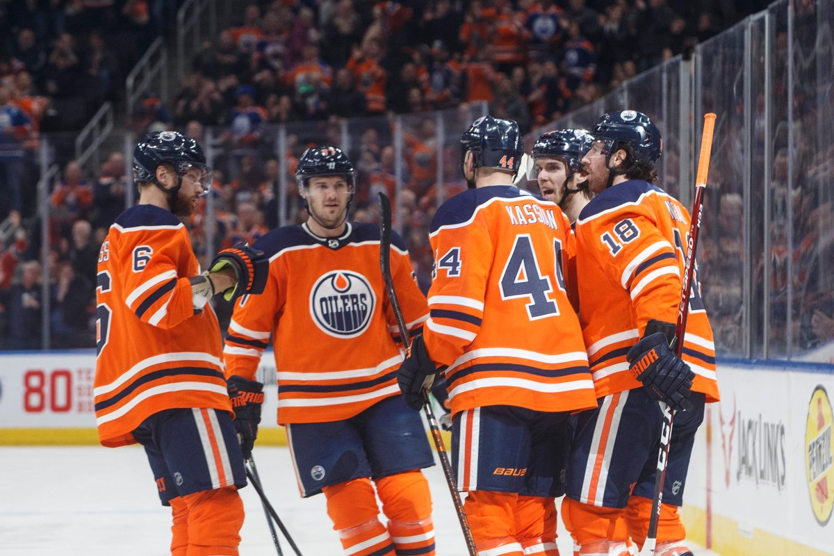 Edmonton Oilers celebrate a goal against the Winnipeg Jets during second period NHL action in Edmonton, Alta., on Wednesday March 11, 2020. THE CANADIAN PRESS/Jason Franson.