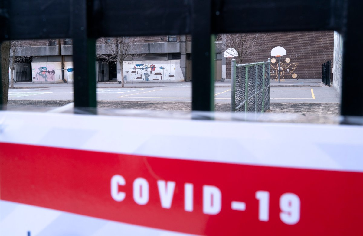A closed schoolyard is seen through its fence in Montreal, Monday, April 27, 2020.
