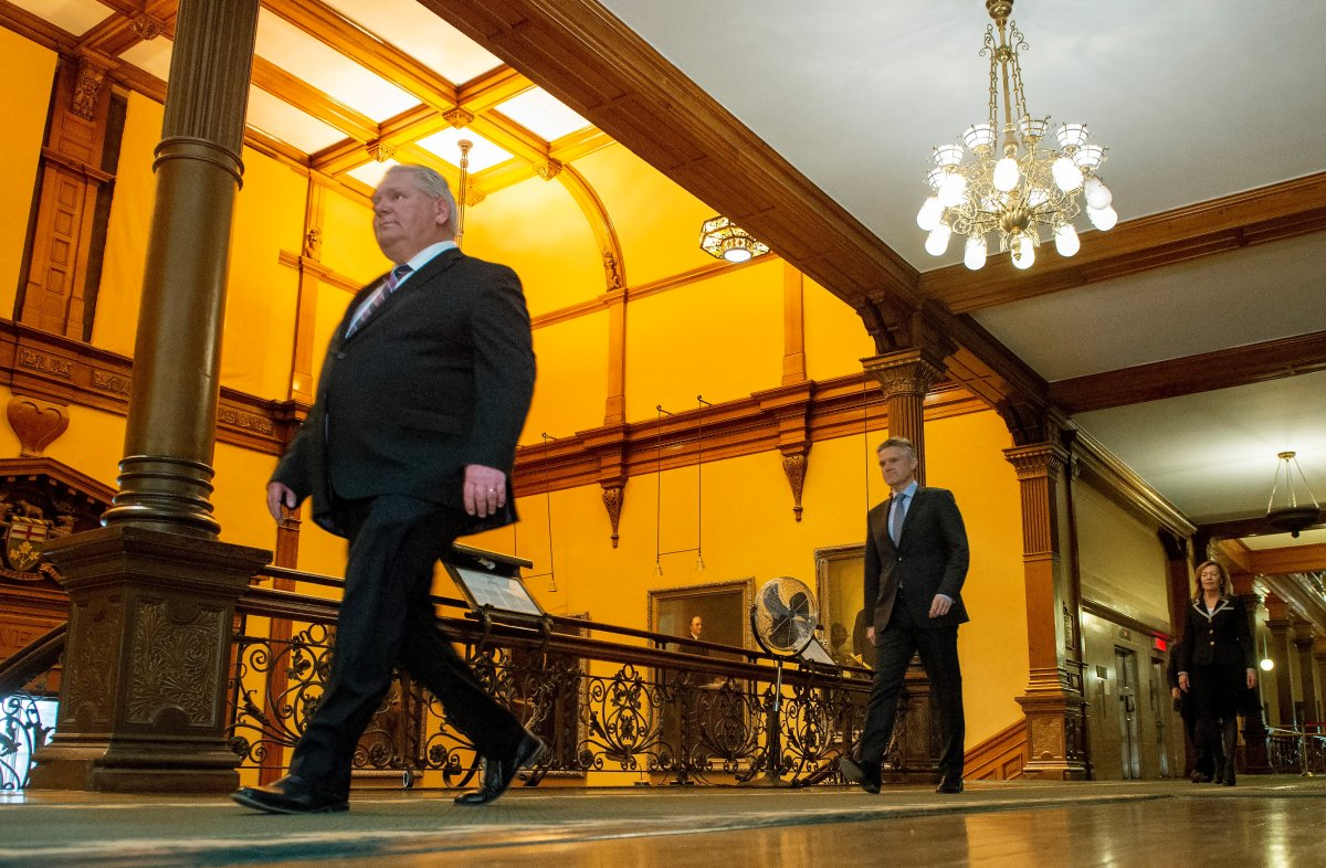 Ontario Premier Doug Ford, Finance Minister Rod Phillips and Health Minister Christine Elliott walk to the daily briefing at Queen's Park in Toronto, Monday, April 27, 2020.