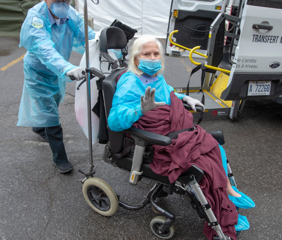 A resident waves as she is brought into the Vigi Mount Royal seniors residence on Friday May 1, 2020 in Montreal.