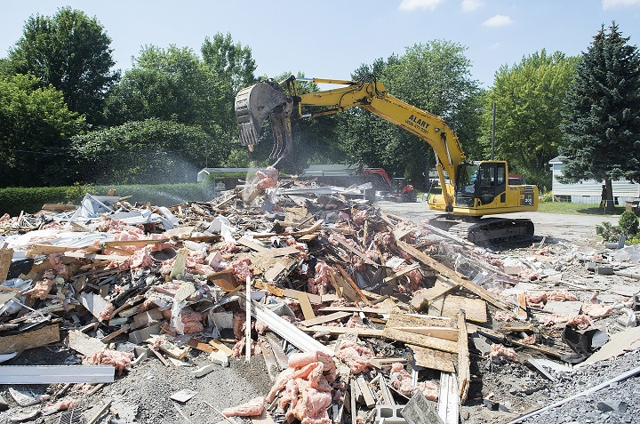 In this Aug. 2019 file photo, a demolition crew removes the remains of a mobile home in Sainte-Marthe-sur-le-Lac following spring flooding. A new study highlights prevention measures to avoid repeat flooding. Friday, May 1, 2020.