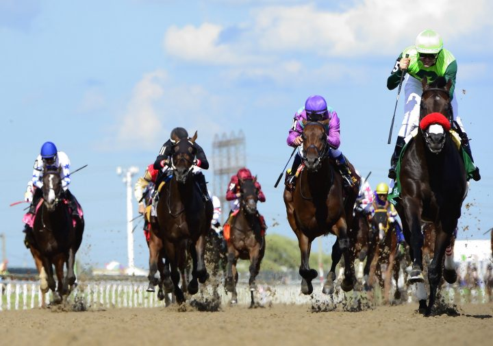 One Bad Boy, right, ridden by jockey Flavien Prat, runs the 160th Queen's Plate at Woodbine Racetrack, in Toronto on Saturday, June 29, 2019. Woodbine Entertainment is looking at a resumption of horse racing next month.