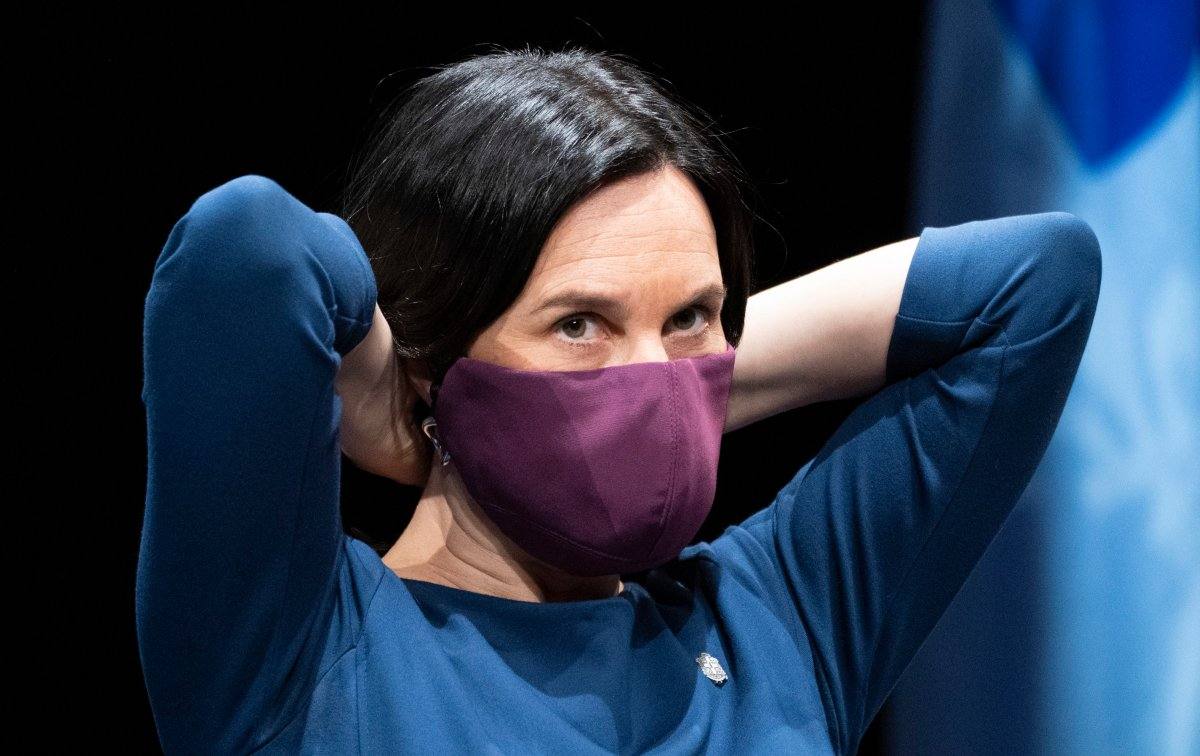 Montreal Mayor Valerie Plante slips on her protective mask during a news conference in Montreal, on Thursday, May 14, 2020.
