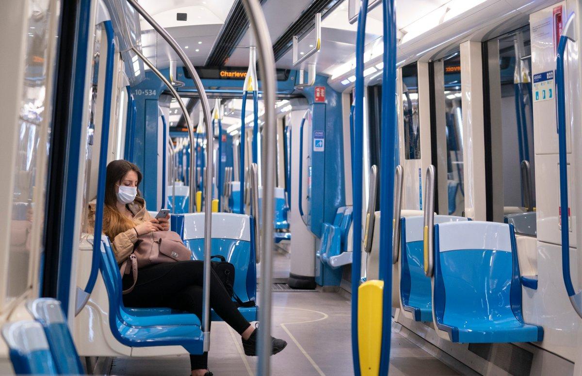 A commuter rides a near empty subway train in Montreal, on Monday, May 25, 2020.