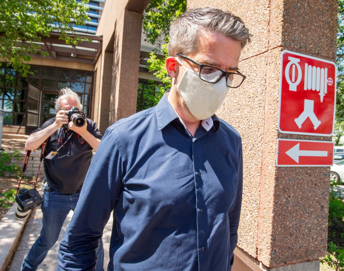 Former Parti Quebecois Leader Andre Boisclair leaves the police station on Friday, May 29, 2020 in Montreal.