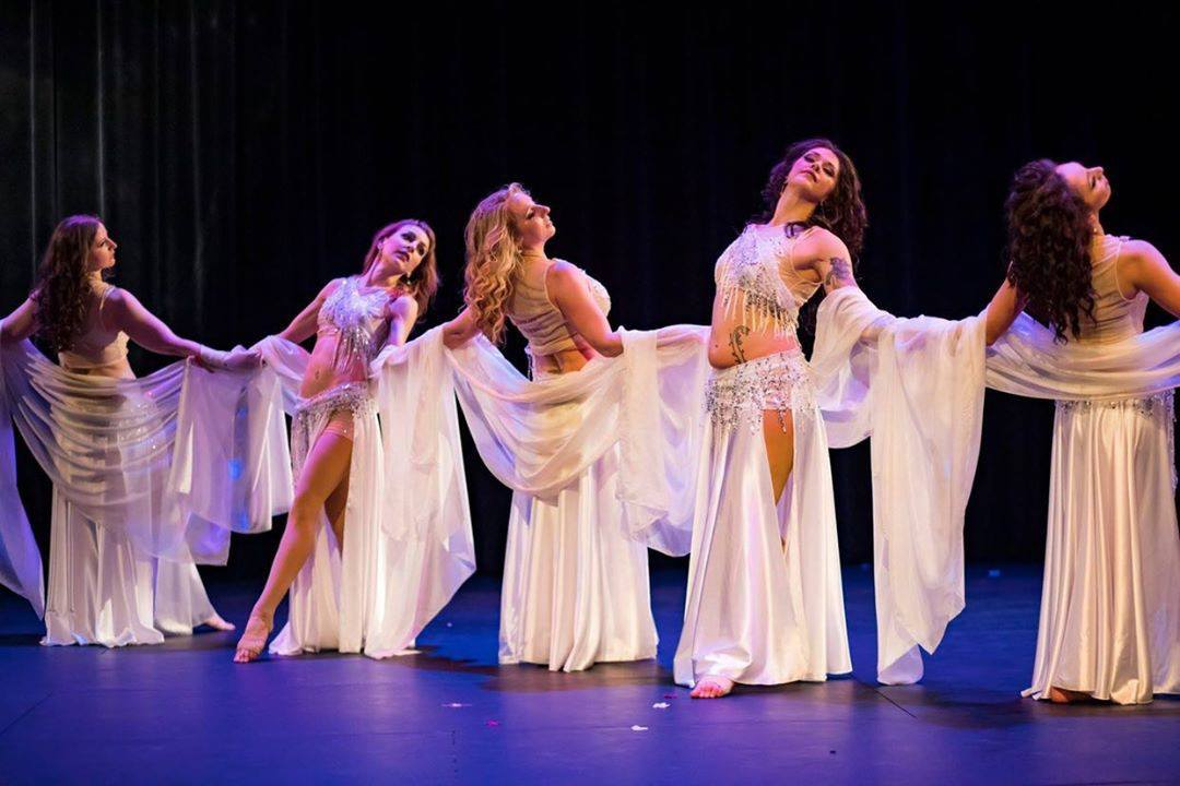 Image of Laura Selenzi and her belly dance troupe in March 2019 dance show called 'Night Gardens.' .