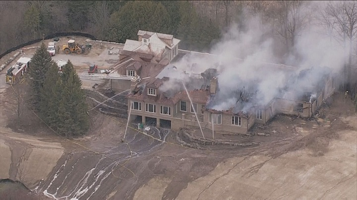 Firefighters on scene battling a fire at a home under construction in Aurora.