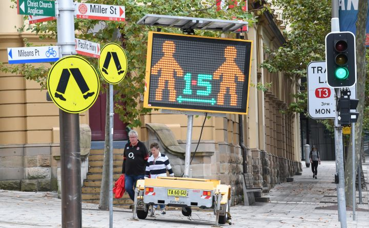 A digital sign warning people to stay at home, wash their hands and remain apart from the person next to them in North Sydney's CBD on April 10, 2020 in Sydney, Australia.