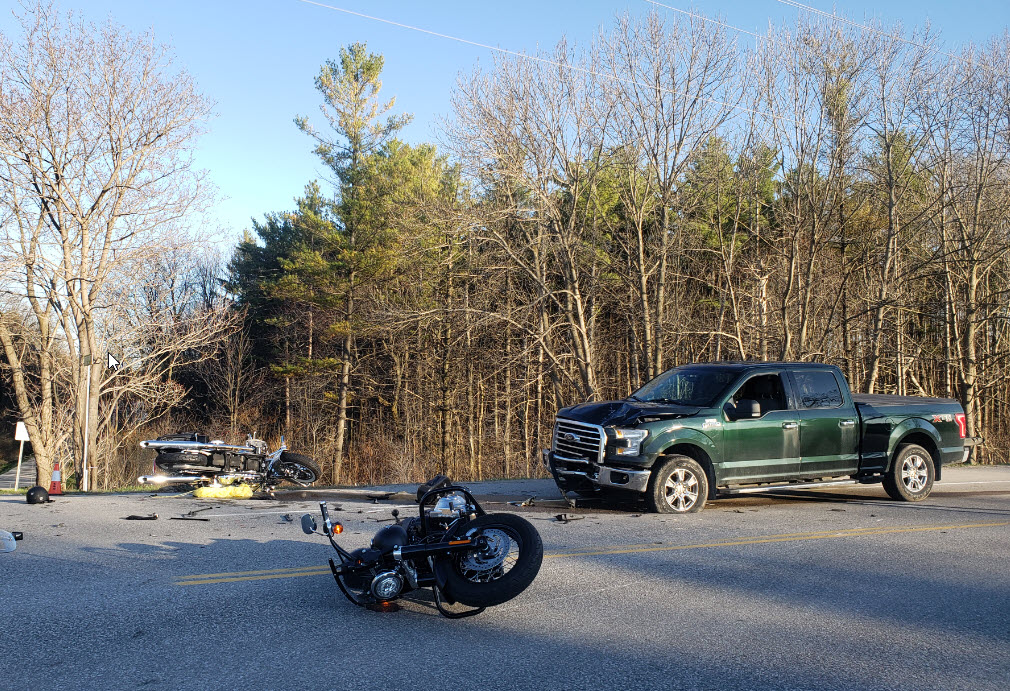 OPP say a motorcyclist died following a crash with a pickup truck north of Guelph on Friday .